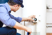 depositphotos_27203821-Hot-water-heater-service